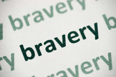 word bravery printed on white paper macro Stock Photo