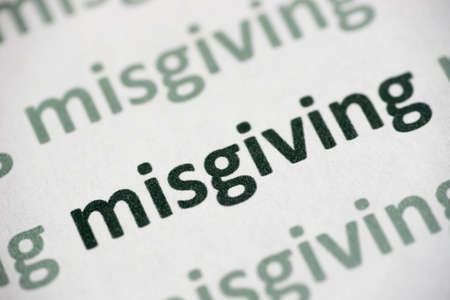 word misgiving printed on white paper macro Stock Photo