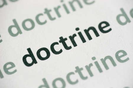 word doctrine  printed on white paper macro