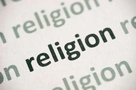 Word religion printed on white paper macro