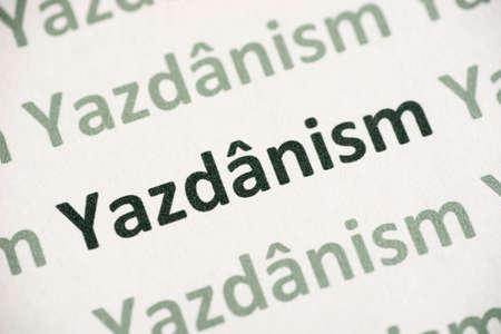 word Jazdanism  printed on white paper macro