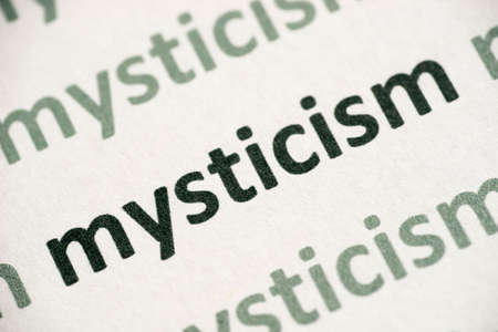 Word mysticism printed on white paper macro Stockfoto