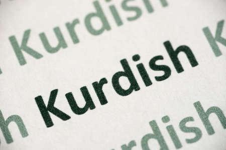 Word Kurdish language printed on white paper macro