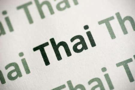 word Thai language printed on white paper