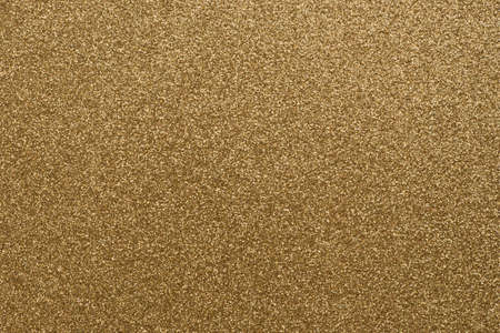 gold color glittering paper background texture
