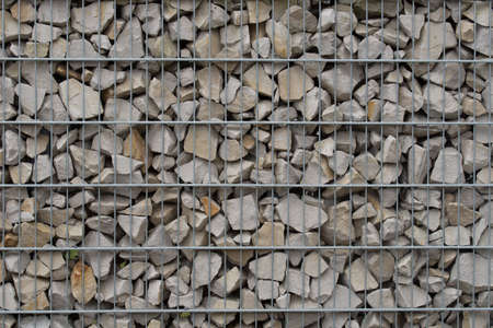 protection fence  or wall made of gabions with gray stones