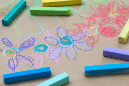 hand drawing on recycled paper - colorful flowers macro