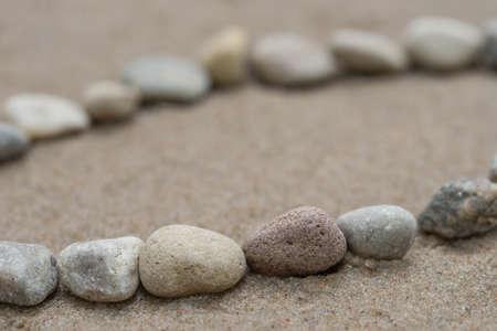 lines of pebbles on sandy background macro Reklamní fotografie