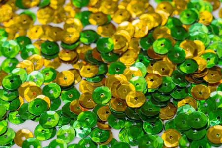 green and golden color sequins macro background