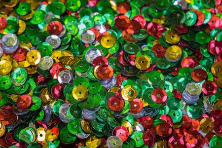 multicolored sequins macro selective focus background Banco de Imagens