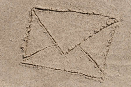 envrelope - drawing on sand background Stock Photo - 124471806