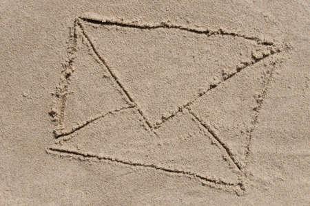 envrelope - drawing on sand background