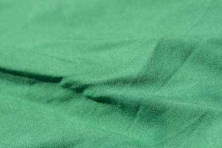 green folded textile background texture Stock Photo