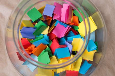 multicolored lottery tickets in jar closeup