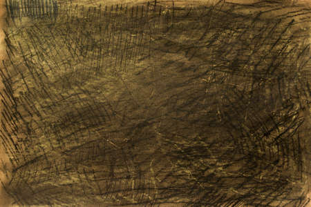 brown pastel crayon on yellow paper background texture