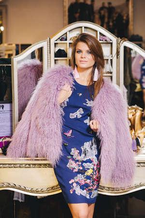 brunette girl posing in blue dress with purple fur