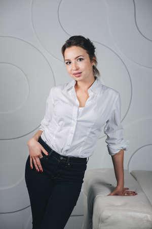 Young beautiful woman standing against white Banco de Imagens