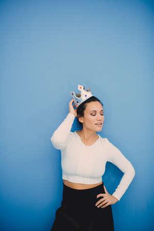 Portrait of beautiful fashion girl on blue background Foto de archivo