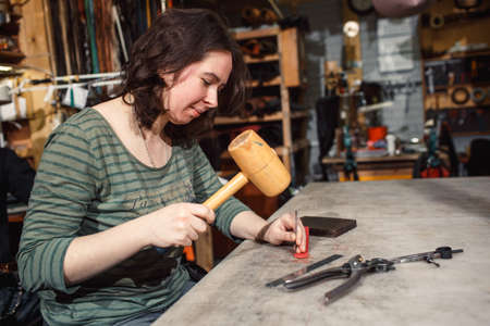 Working process in the leather workshop.