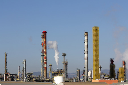 Large oil refinery complex, with chimneys and towers