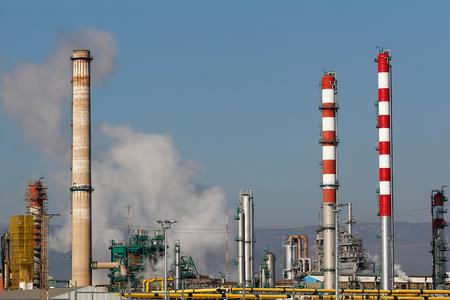 Oil refinery chimneys and smoke stacks