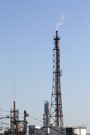 Industrial smoke from chimney in a refinery photo