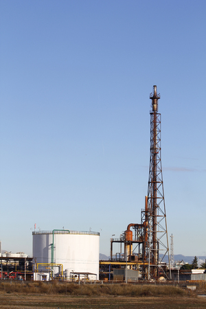 High tower and silo in a refinery photo