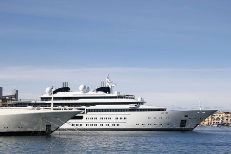 moored: Luxury yacht moored at harbor Stock Photo