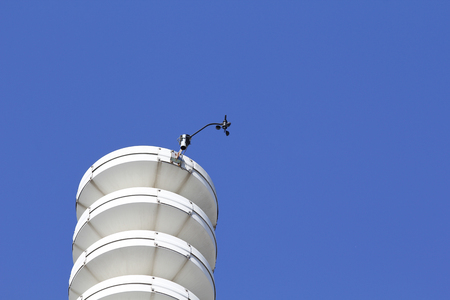anemometer: Weather station with anemometer, against blue sky Stock Photo