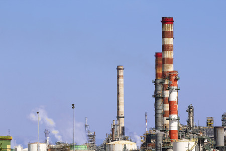 Industrial chimneys in a large oil refinery photo