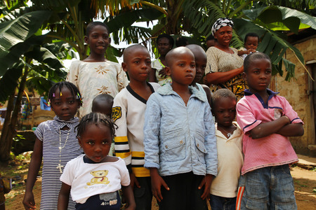 AKURE, NIGERIA - AUGUST 12, 2012  Nigerian boys and girls  stand up for a portrait in a local village at  Ondo state in Nigeria, on August 12, 2012