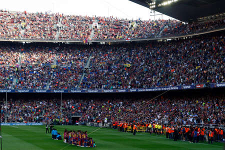 BARCELONA, SPAIN - MAY 08, 2011  Spectators in a sold out Barcelona football stadium during the match between FC Barcelona and RCD Espanyol on May 08, 2011 in Barcelona, Spain