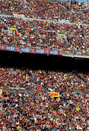BARCELONA, SPAIN - MAY 08, 2011: Spectators in a sold out Barcelona football stadium during the match between FC Barcelona and RCD Espanyol on May 08, 2011 in Barcelona, Spain.
