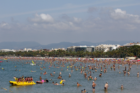 SALOU, SPAIN - JUNE 22  People relaxing and having fun on the beach to have their holidays on June 22, 2014 at the coast of Salou, Spain, a famous tourist destination