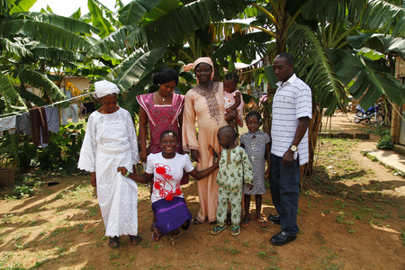 AKURE, NIGERIA - AUGUST 12, 2012  The members of a nigerian family from Akure, show their traditional clothes for a portrait, in a local village at Ondo state in Nigeria, on August 12, 2012