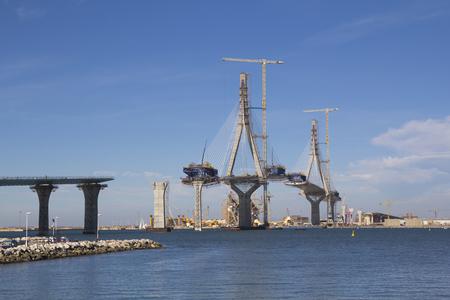 La Pepa bridge on construction, over the sea  in Cadiz, Spain Фото со стока