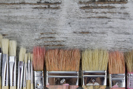 handimade: Set of paintbrushes in a wood background, vintage
