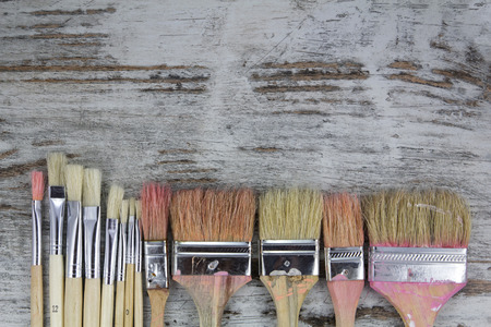 Set of paintbrushes in a wood background, vintage photo