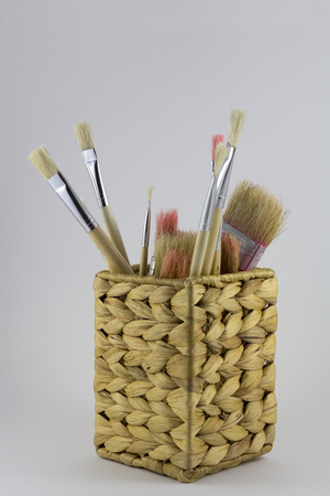 Set of paintbrushes in a wicker pot