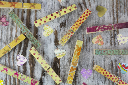 Handmade clothespins in a wood background, vintage photo