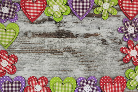 Colorful handmade objects in a frame composition, wood background photo