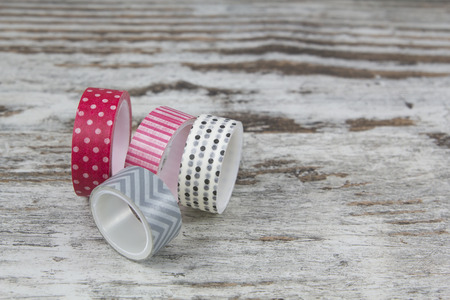Washi tape rolls, in a wood background