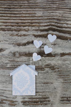Handmade house in a wood background, vintage