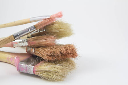 Set of old paintbrushes in a white background