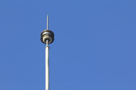 Lightning rod against blue sky