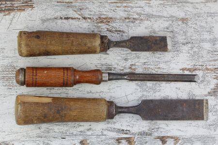 Old wood cutting tools for the carpentry photo