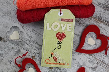 cross stitch: Handmade tag with cross stitch