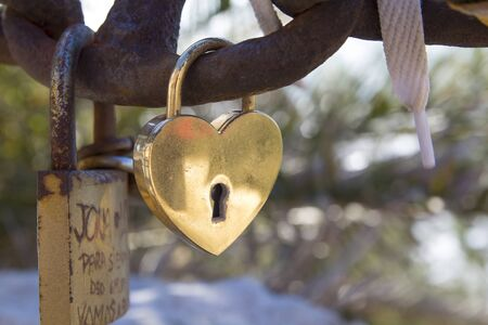 Padlock with a heart in a chain photo