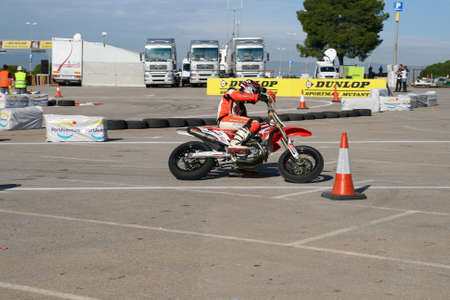port aventura: SALOU, SPAIN, NOVEMBER, 15, 2009: Unidentified pilot of motorcycling in the amateur championship of supermotard, a local exhibition in Port Aventura on September, 15, 2009 in Salou, Spain