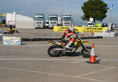 SALOU, SPAIN - SEPTEMBER, 15, 2009: Unidentified pilots of motorcycling in the amateur championship of supermotard, a local exhibition at Port Aventura on September, 15, 2009 in Salou, Spain